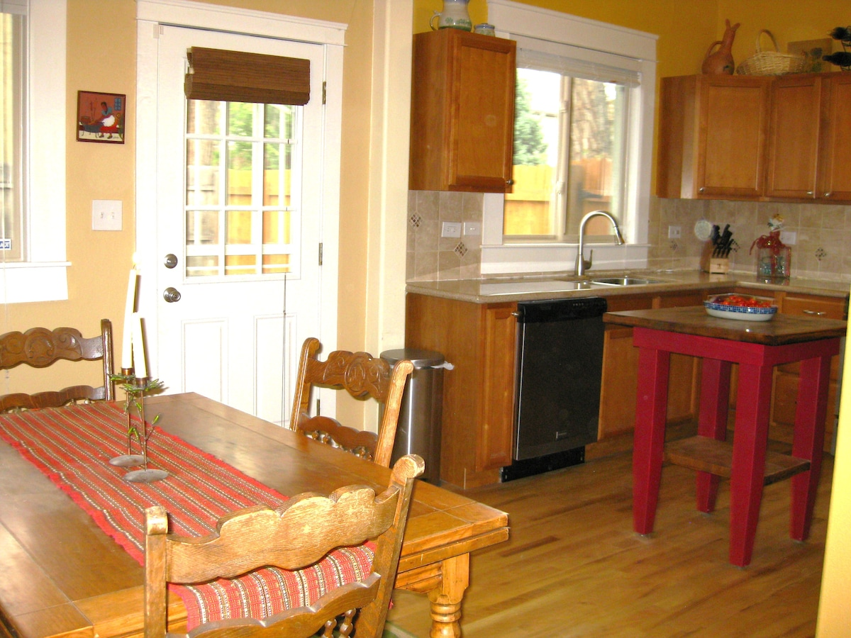 View of dining room and kitchen.
