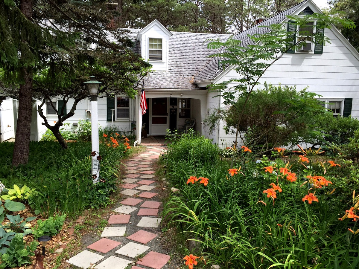Waterfront wood acre Cape Cod home