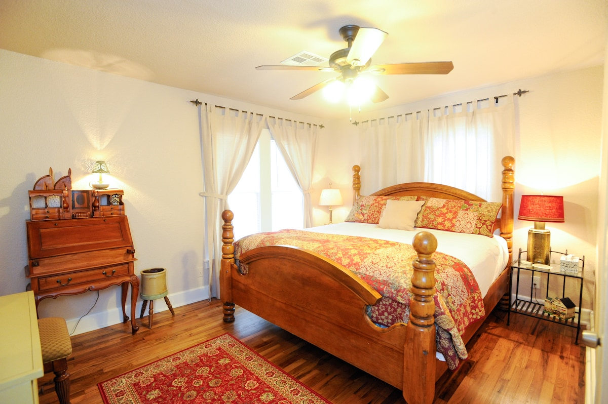King bedroom with wonderful bedding and soft new linens.  Makeup table with mirror and dresser.