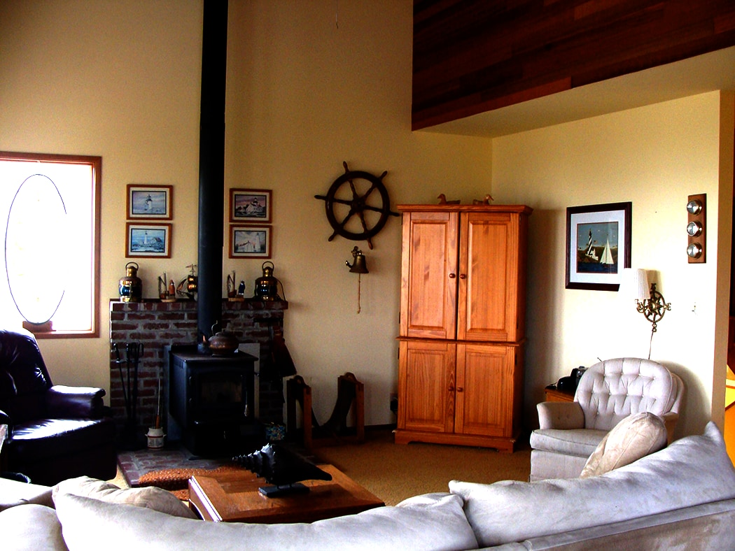 The living room boasts a woodstove for chily nights, TV w/satellite, Wi-Fi router, and ocean views.