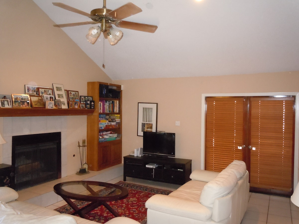 The living room has leather couches and a TV with Netflix and Blueray player.  There are plenty of board games for you to enjoy.