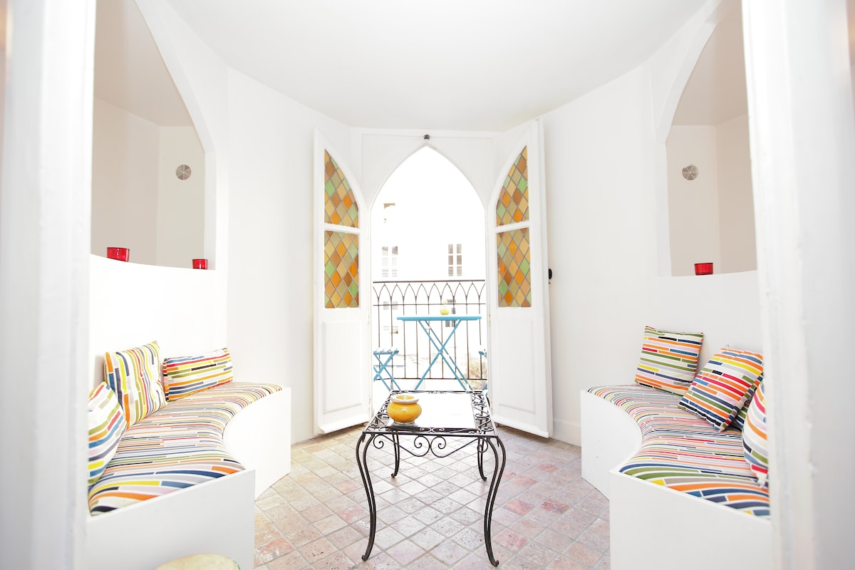 After going up some stone & wood stairs, discover the indoor terrace & outdoor balcony overlooking the garden