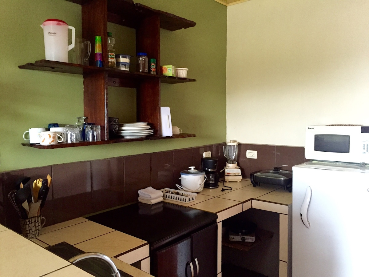 Fully equipped kitchen (refrigerator, hot plate, electric skillet, rice cooker, microwave,  coffee maker).  Tea, coffee, salt, sugar included.