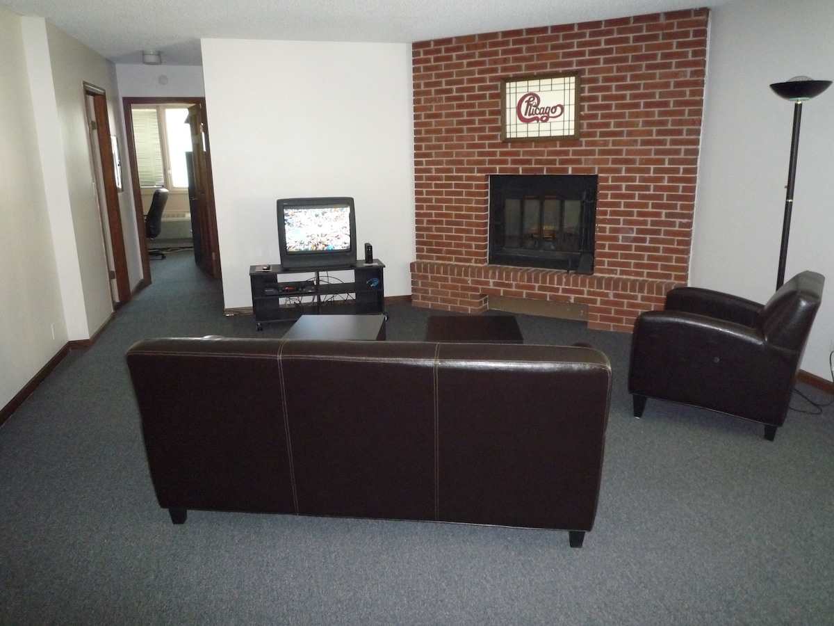Unwind in the living room with TV. Internet, and a fireplace