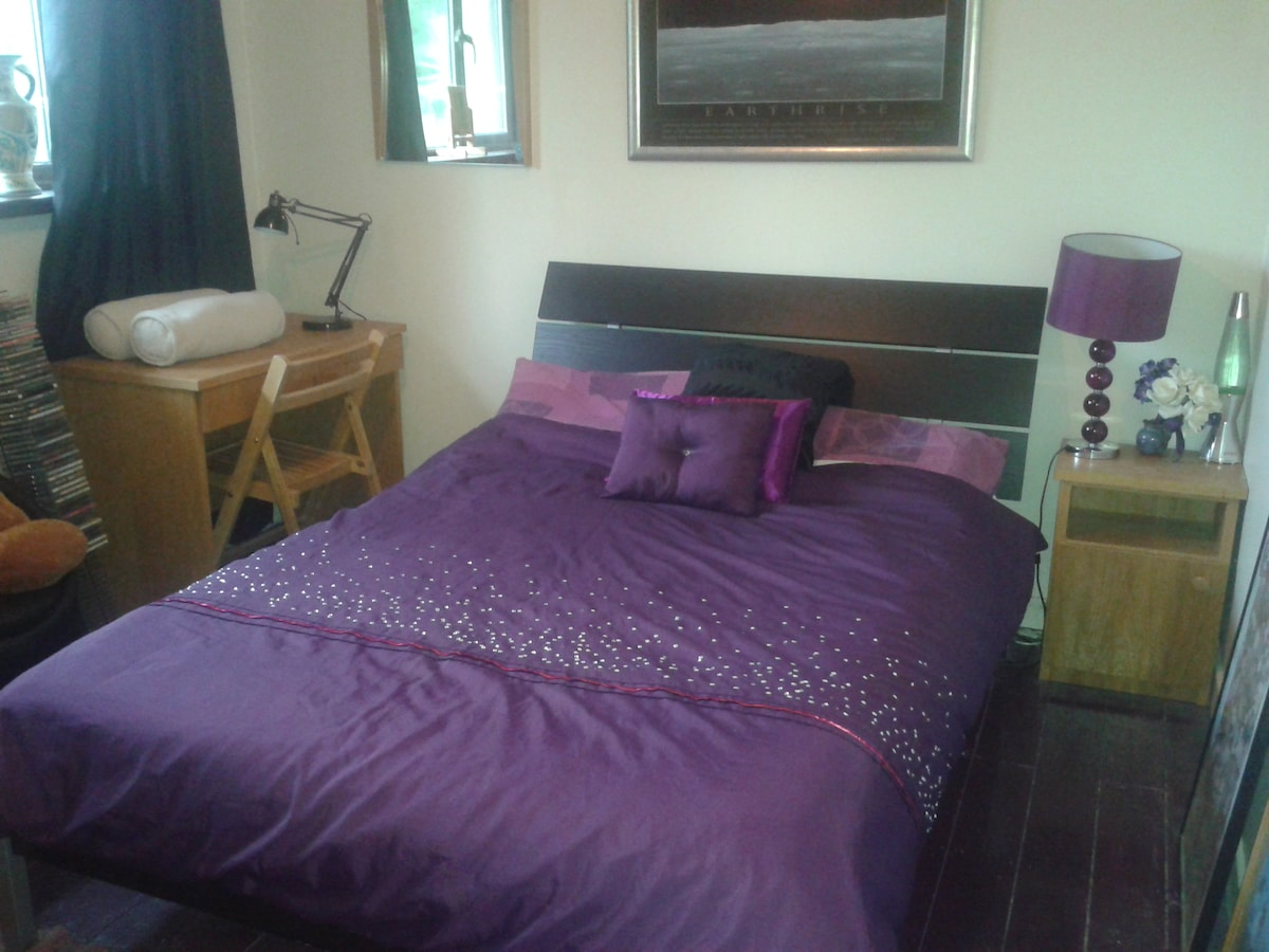 Attractive bedroom with double bed.