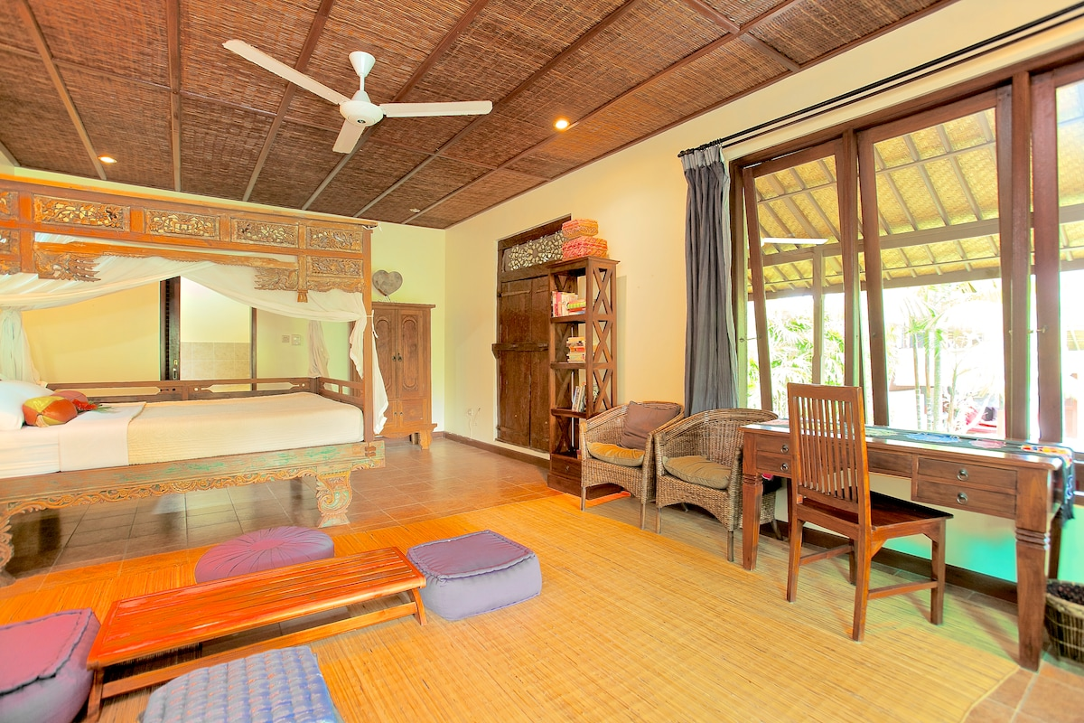 Downstairs, Bedroom #2, antique Javanese bed, TV lounge area, desk, ensuite large bathroom