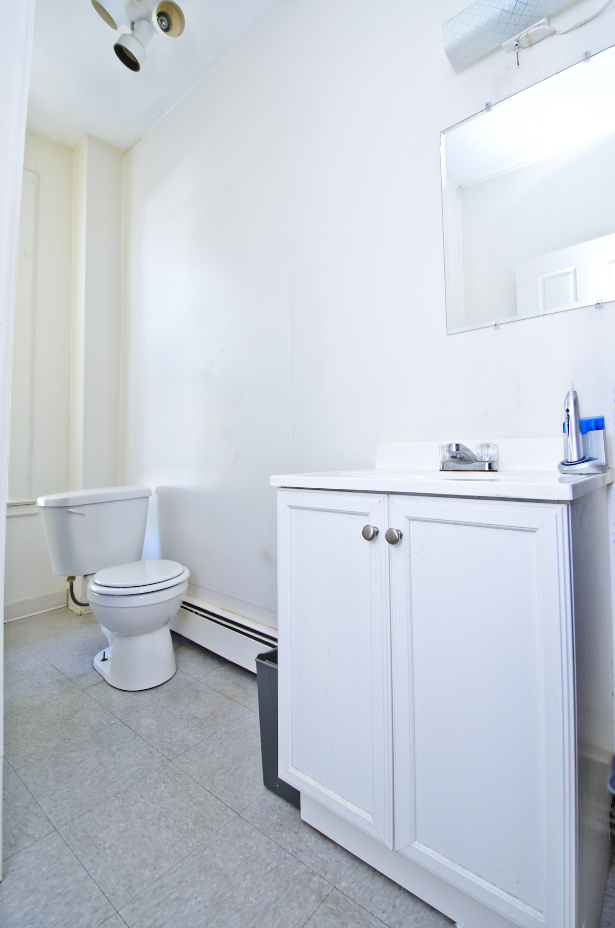 Private Bathroom w/stand-up shower and linen closet.