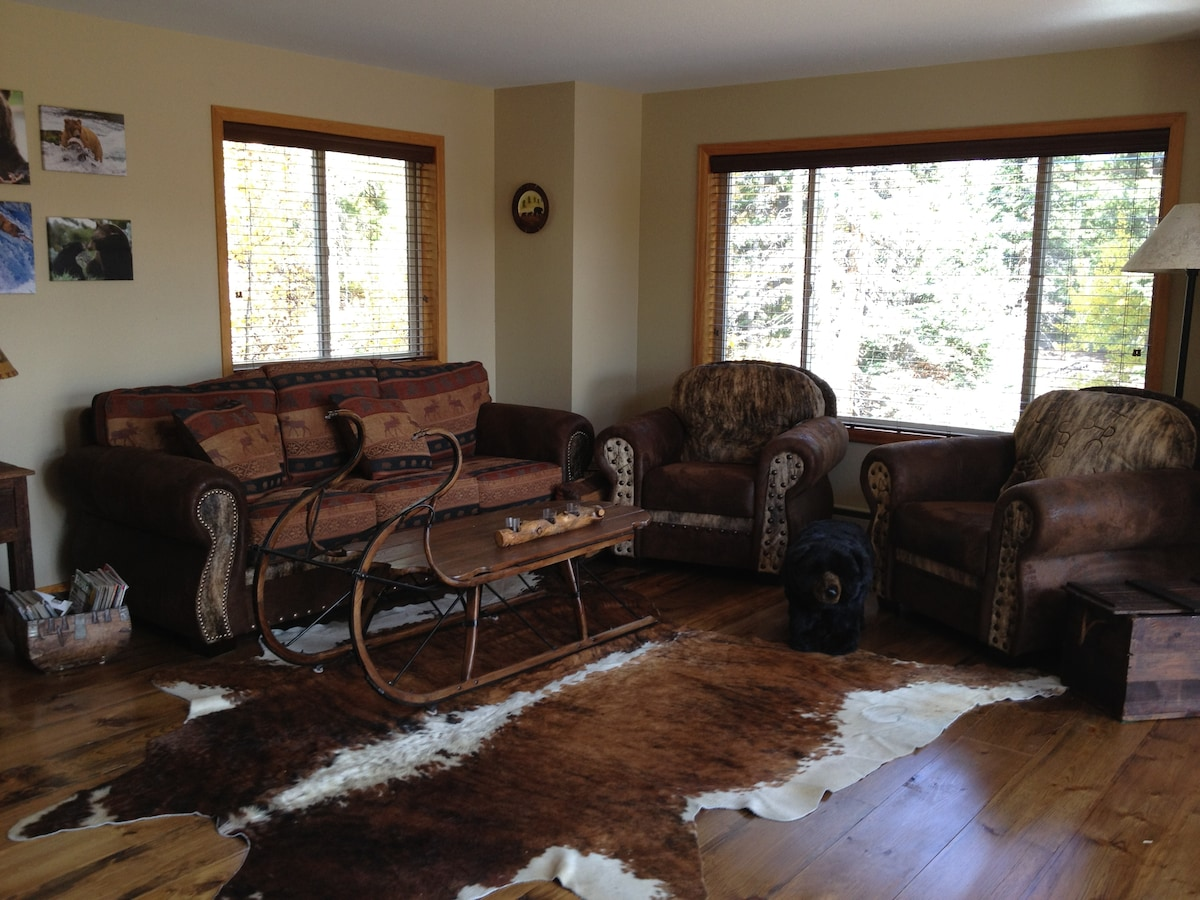 Living room- natural cowhide skins, overstuffed cozy chairs
