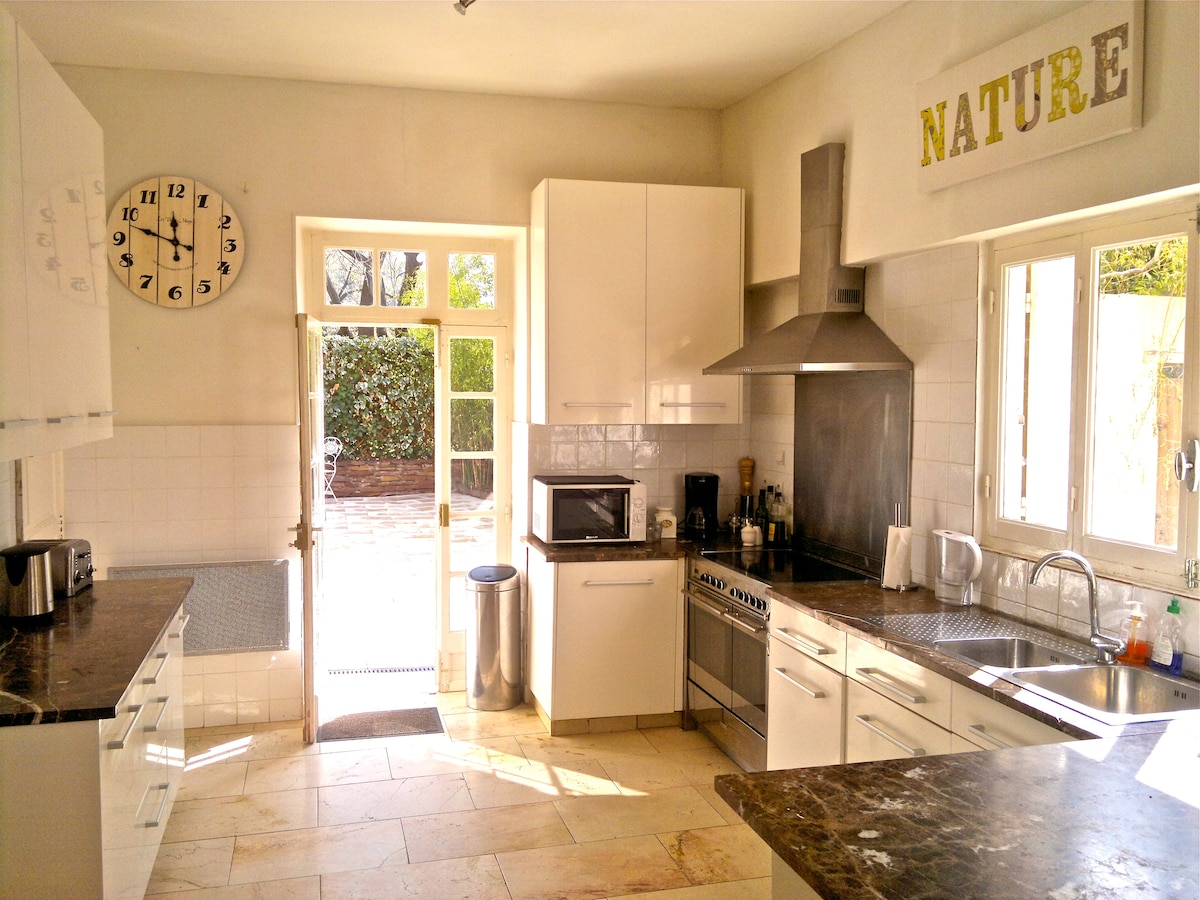 Kitchen opening out onto the shade terrace
