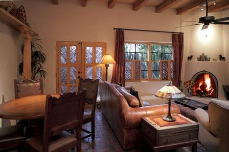 Living room and dining room, airy and bright from skylights; TV and music in Santa Fe style cabinet