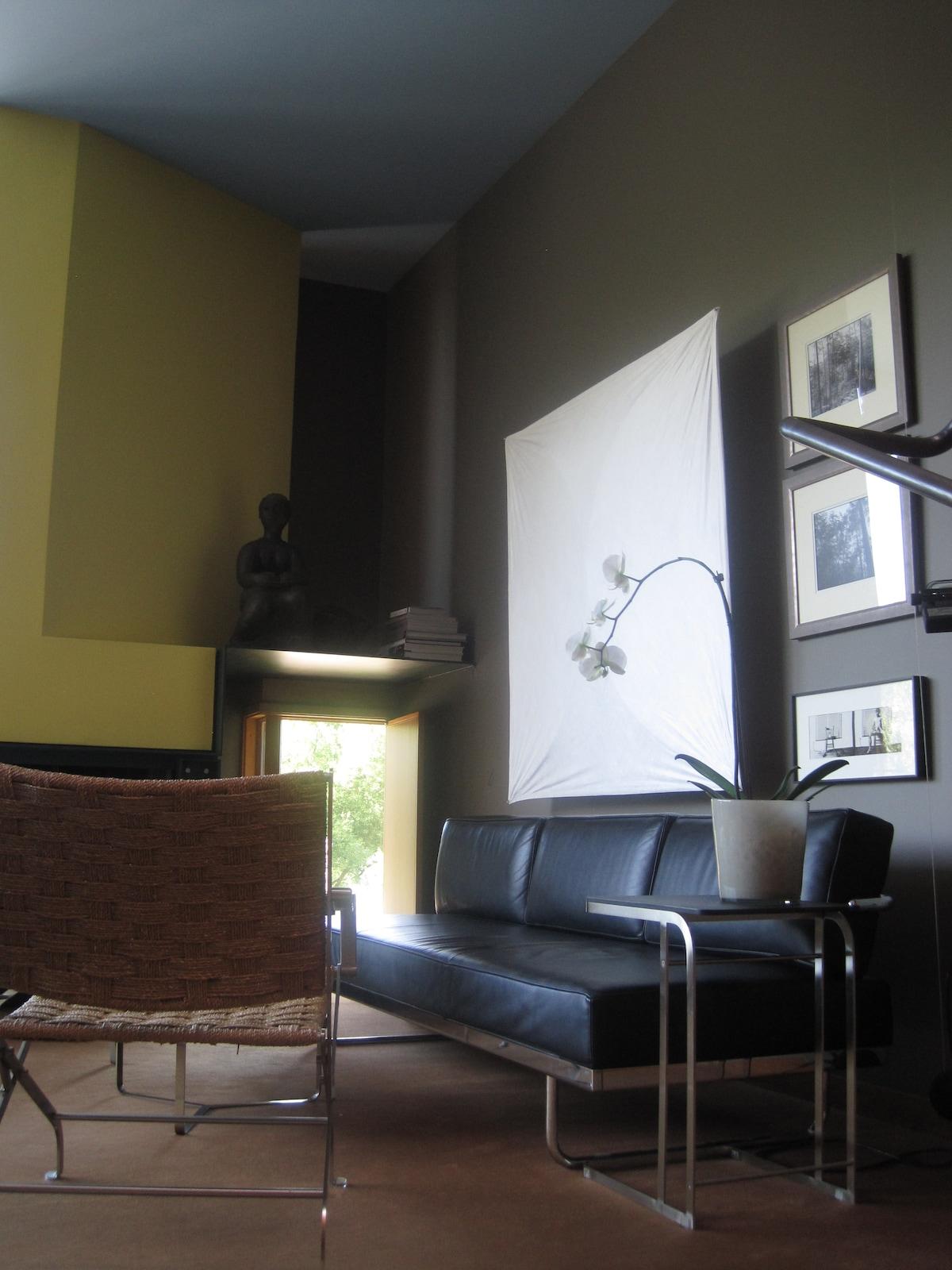 Living room of Rundles Morris House.  Designer furnishings, lighting, unique artwork, etc.