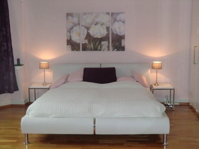 Supremely comfortable double bed with freshly pressed linen,night -tables and lamps.