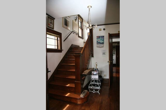 Grand staircase at the entry way. Meticulously restored woodwork throughout the house.