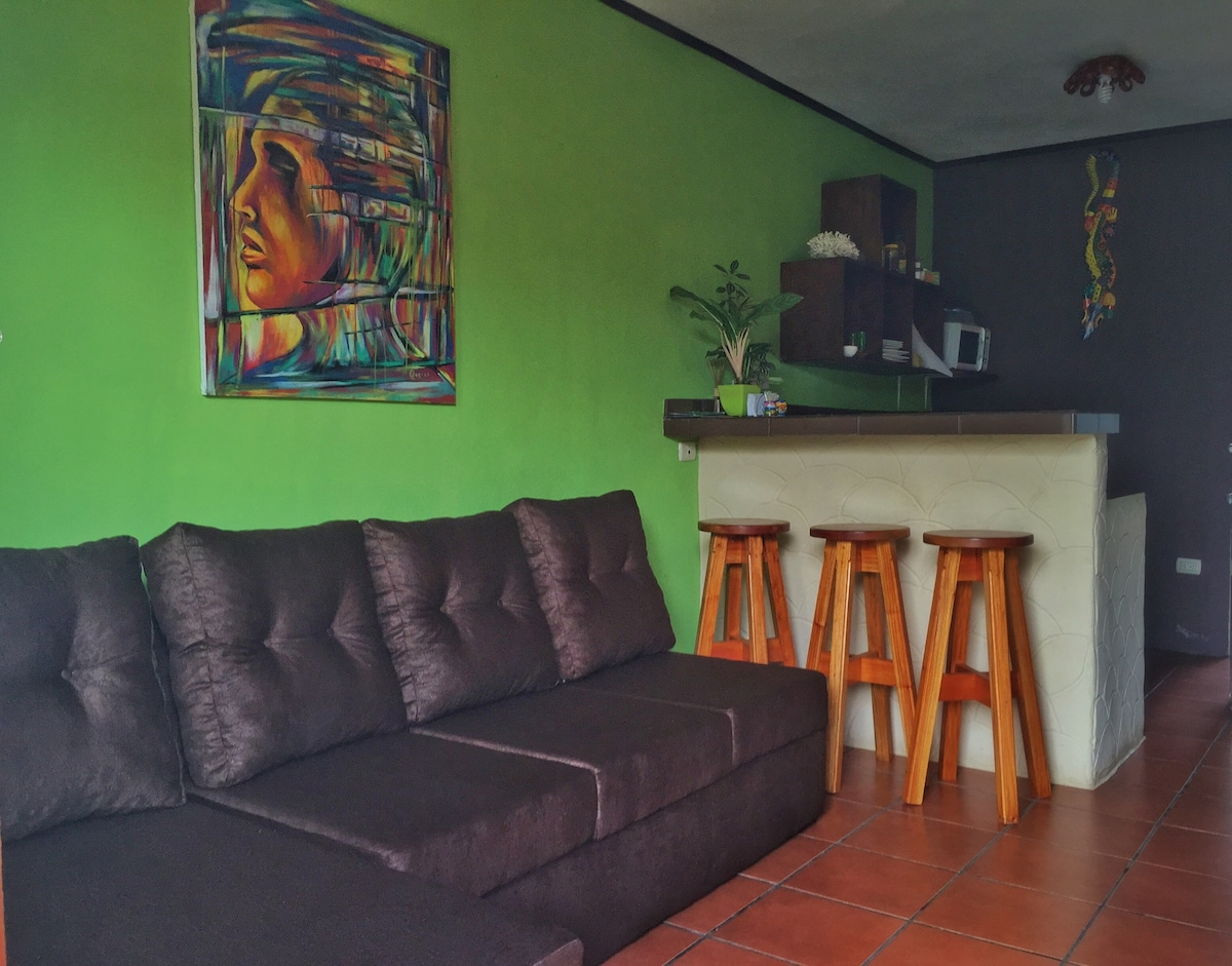 """Living room with NEW couch, 32"""" TV with cable + fully equipped kitchen (refrigerator, hot plate,  electric skillet, rice cooker, blender, microwave,  coffee maker).  Tea, coffee, salt, sugar included. Additionally; 2 separate bedrooms with A/C and more."""