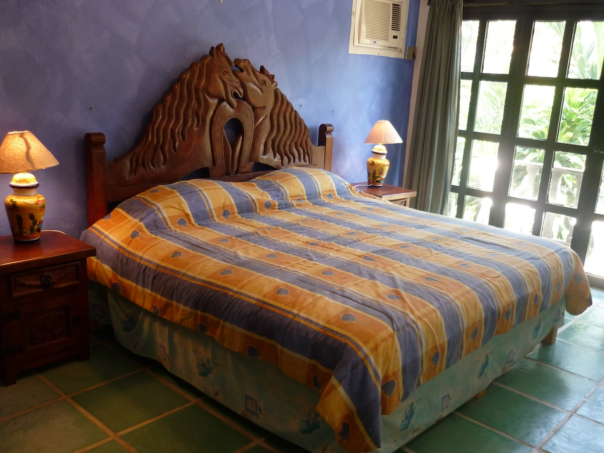 Nice balcony off the king room with a view to the gardens and pool.  Both bedrooms have a/c for your comfort.