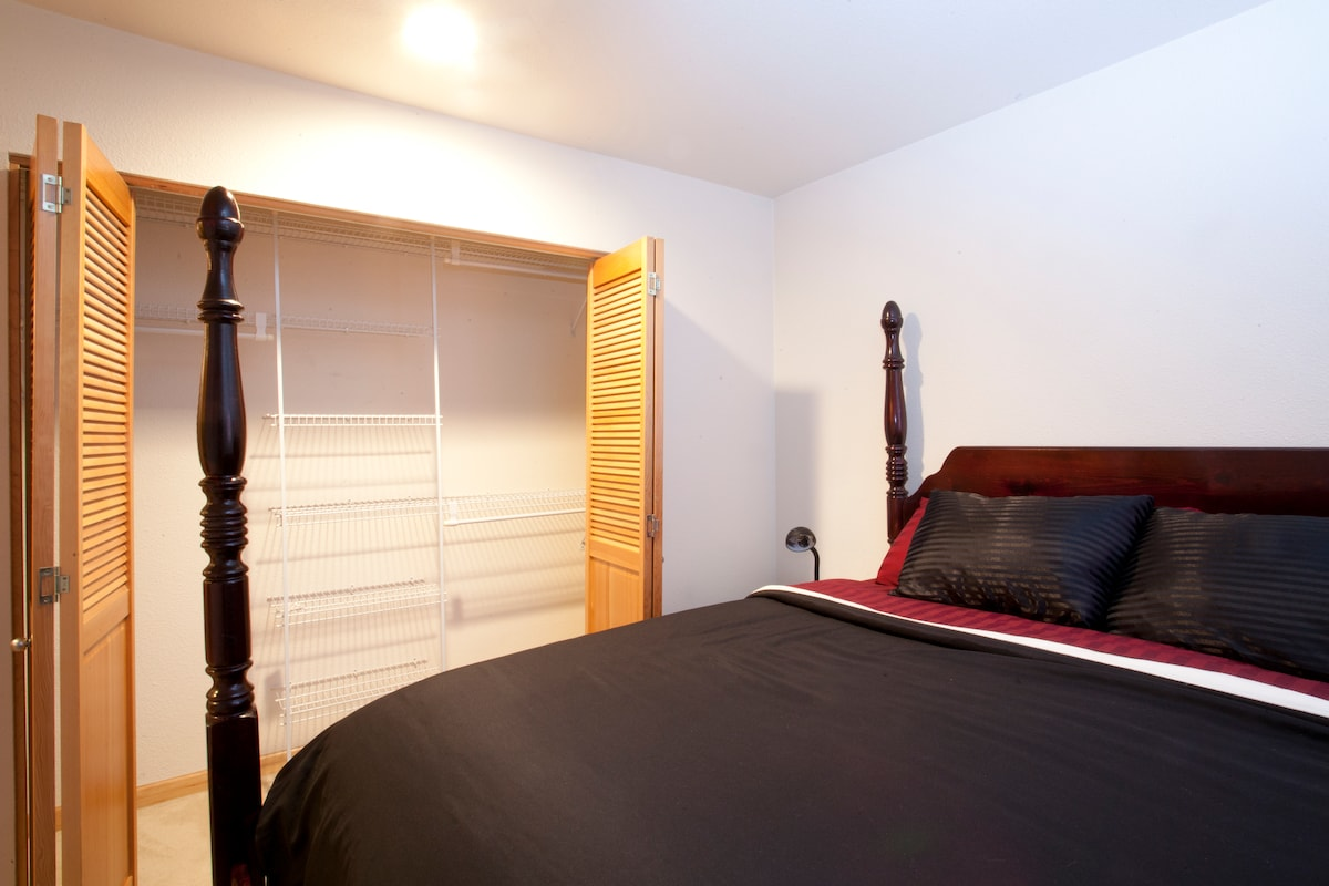 King-size bed with closet open