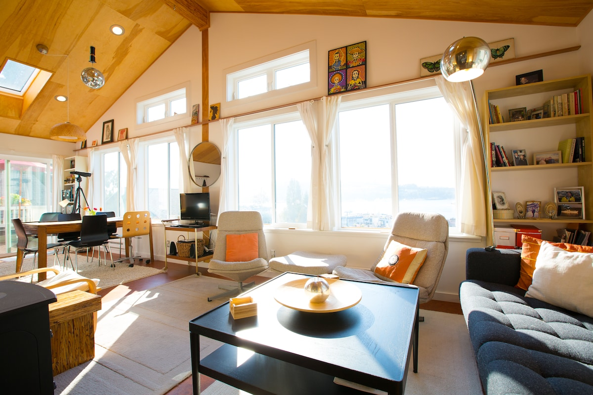 Warm birch paneling and a mid-century style.