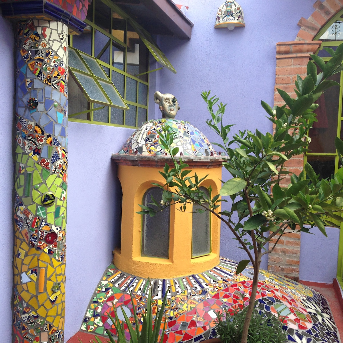 Artful mosaics adorn the boveda on the terrace.