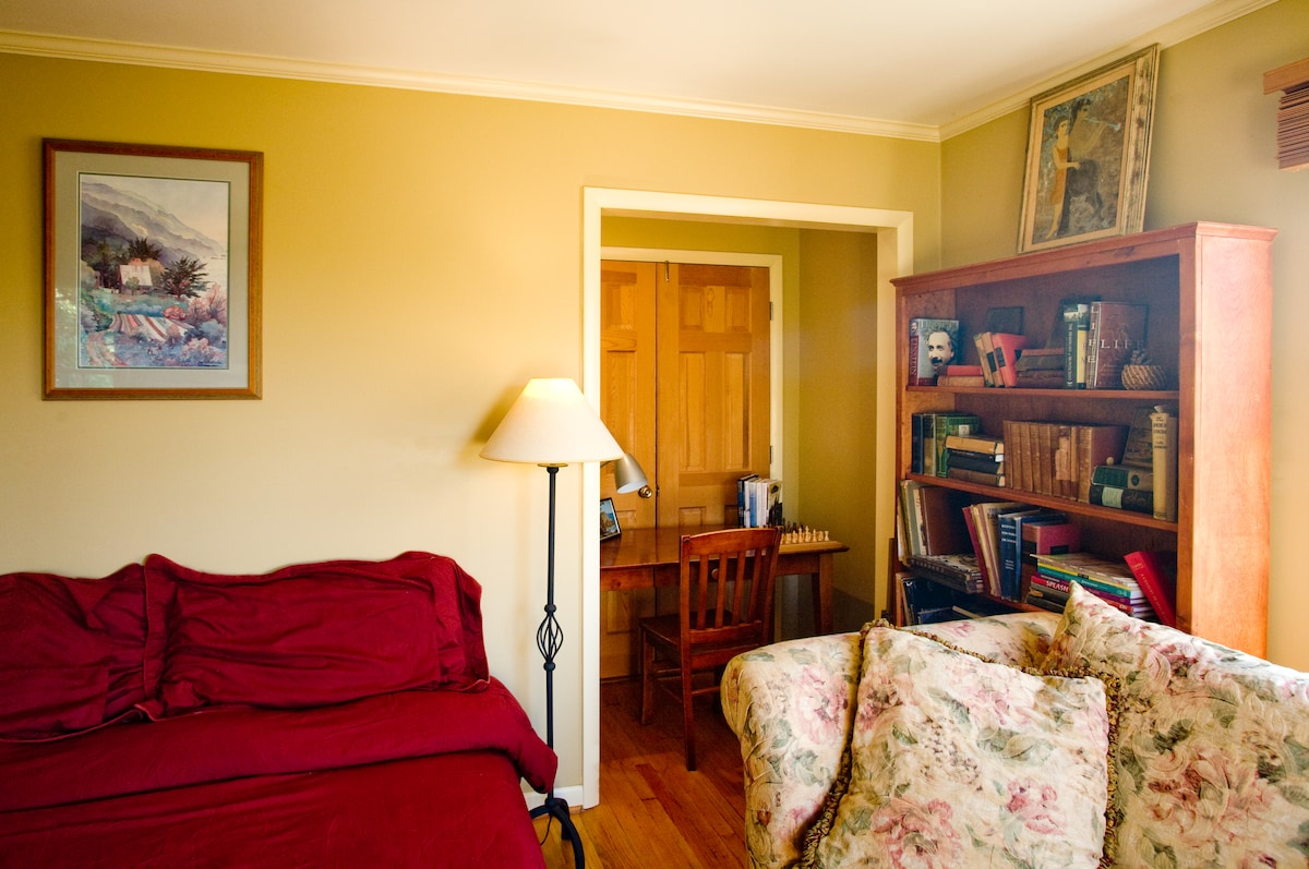There is a writing nook in the corner of the room.
