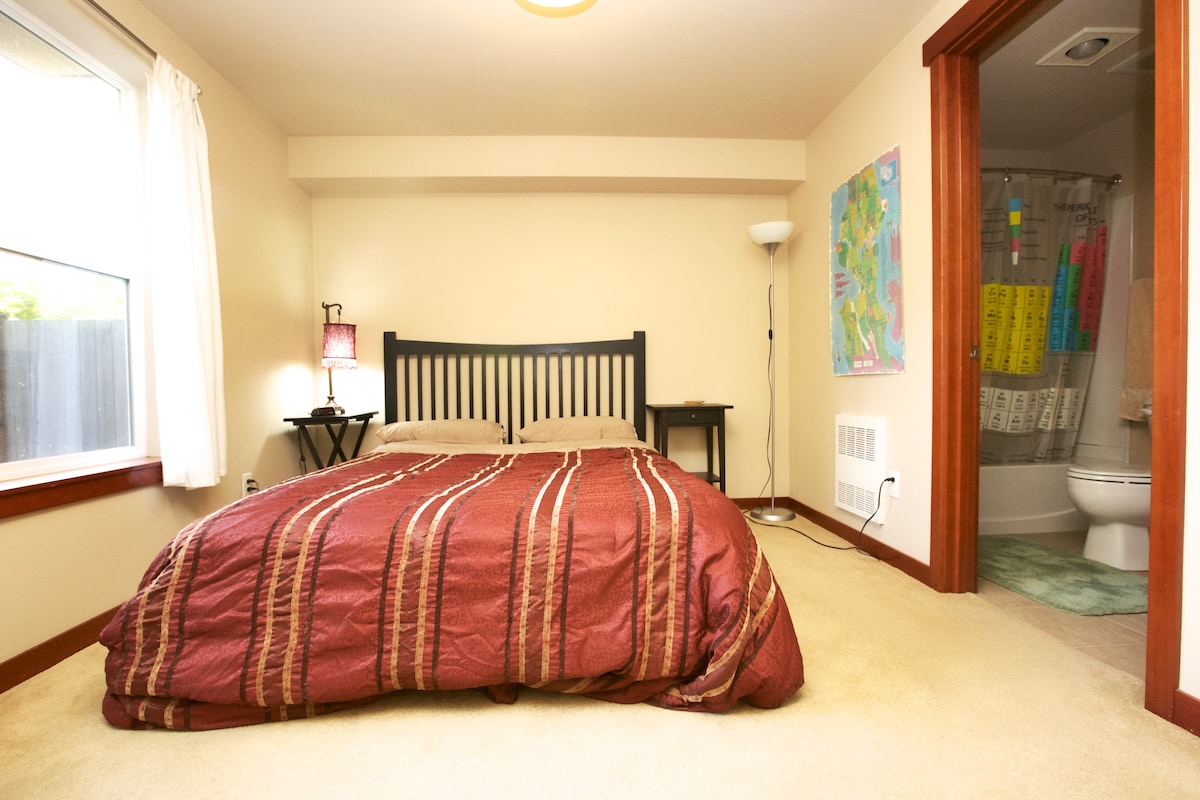 This is your ground floor room with queen bed, private bath and easy access to the back patio.