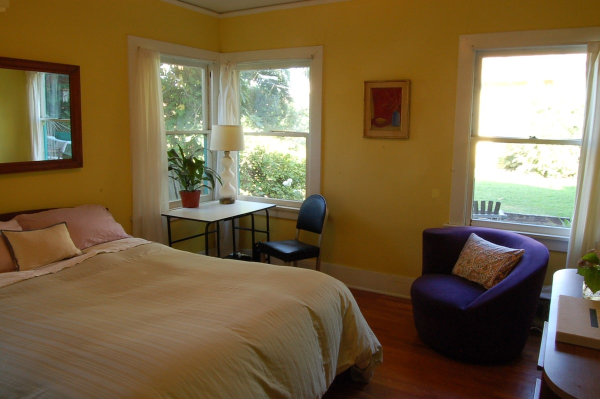 Yellow bedroom, as previously furnished.  See next picture for morning light.