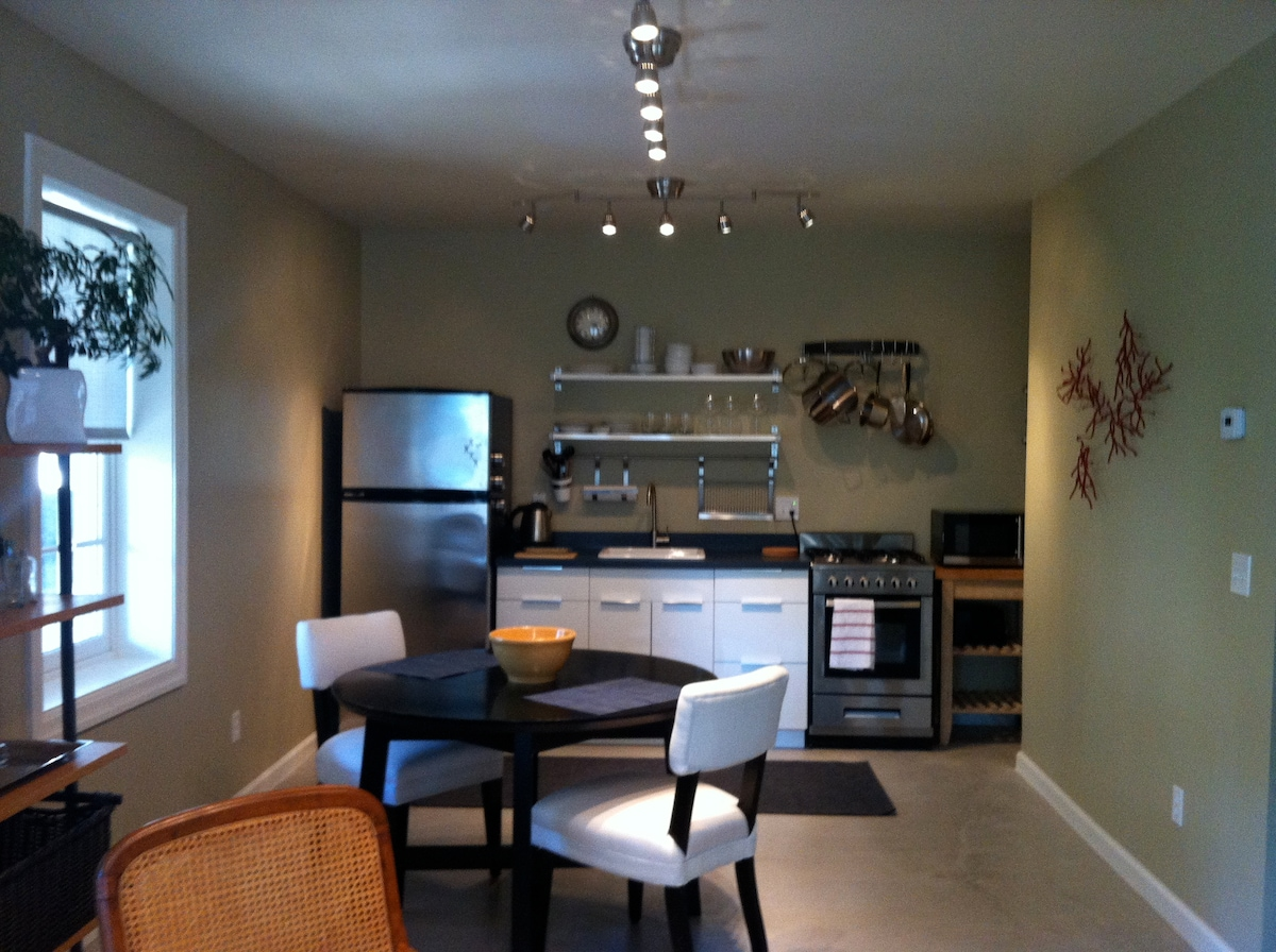 Kitchen is fully stocked with necessary items to do your own cooking, including refrigerator, sink, stove/oven, microwave, and toaster