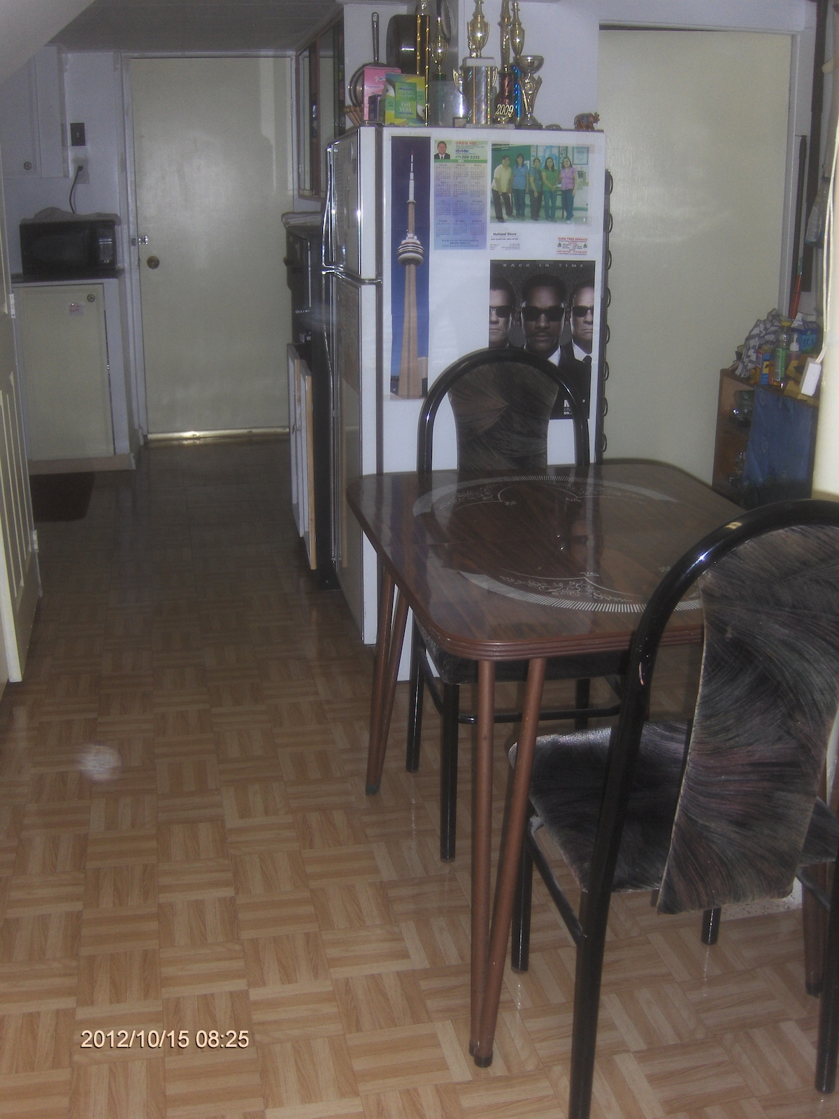 Shared fridge and eating table. .