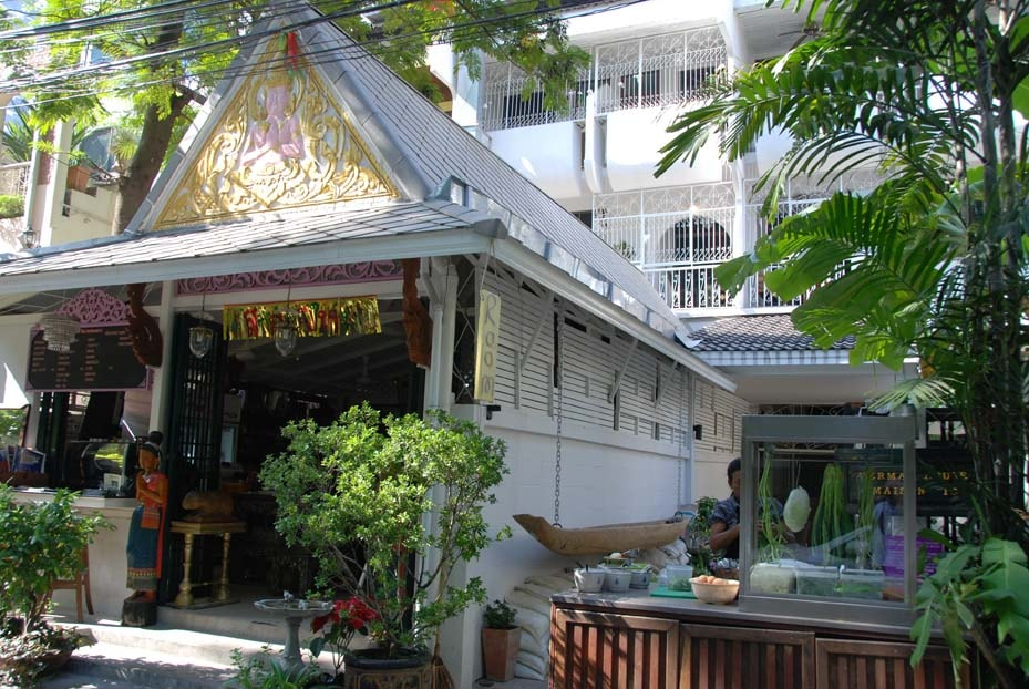 Welcome to Cafe ice Residences.  View of Maison ice (left) & Herma House (right) with our Thai restaurant in the foreground and the view into the Herma House garden just before lunchtime