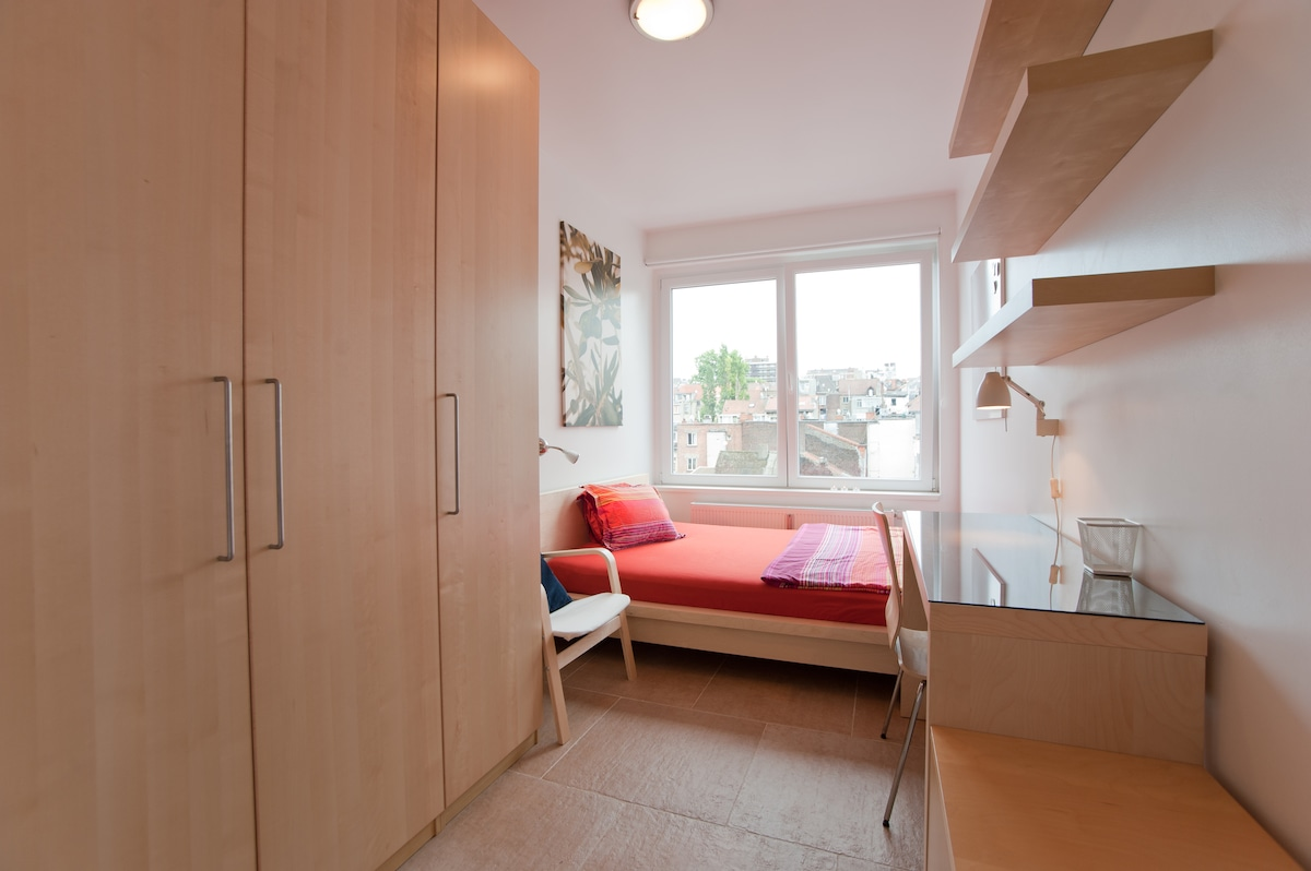 Large wardrobe, comfy bed, table and lots of storage place