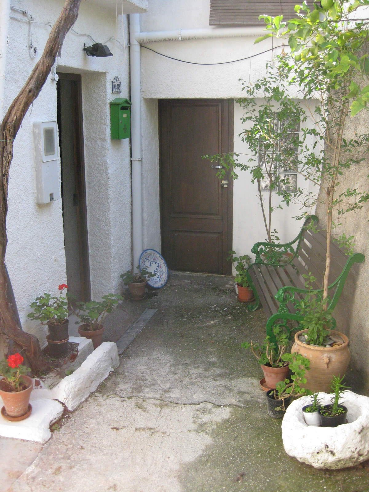 Entrance to the house. Front door on left.