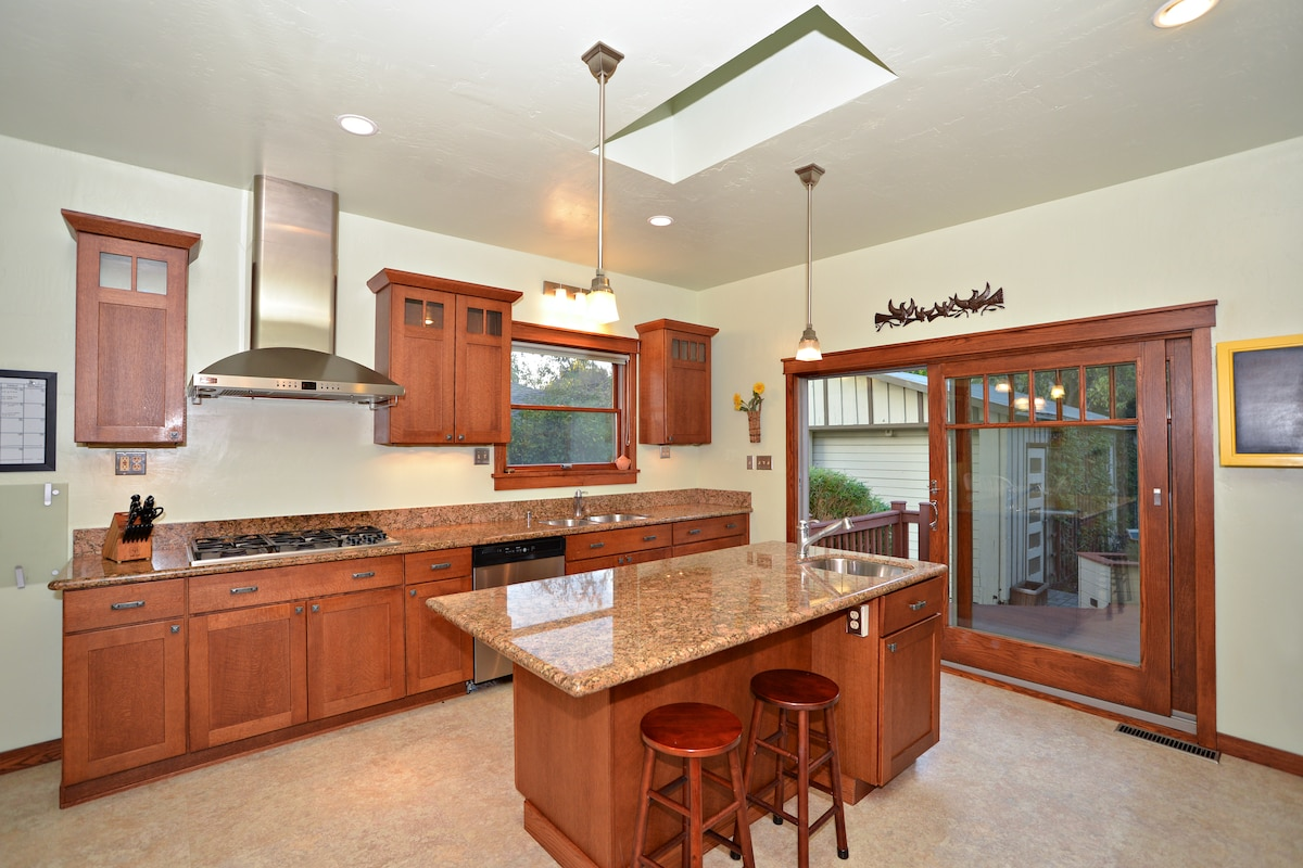 Large Kitchen with Island,  Two Sinks and Stainless Steel Appliances