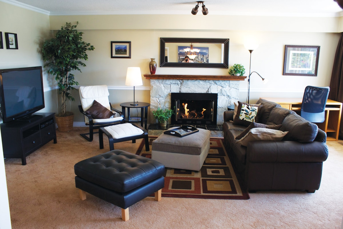 "Living room with gas fireplace, 50"" HDTV"