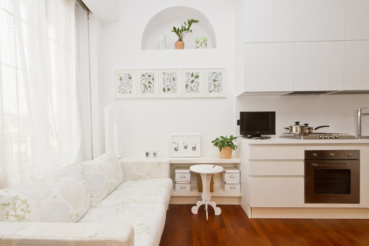 Living room, sofa and part of design Kitchen. *** myhomeinMilan, Milan, Italy