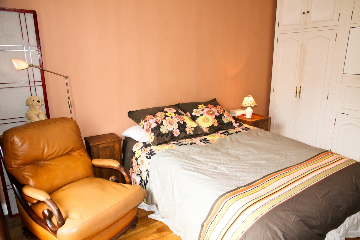 Bedroom - club chair, queen bed