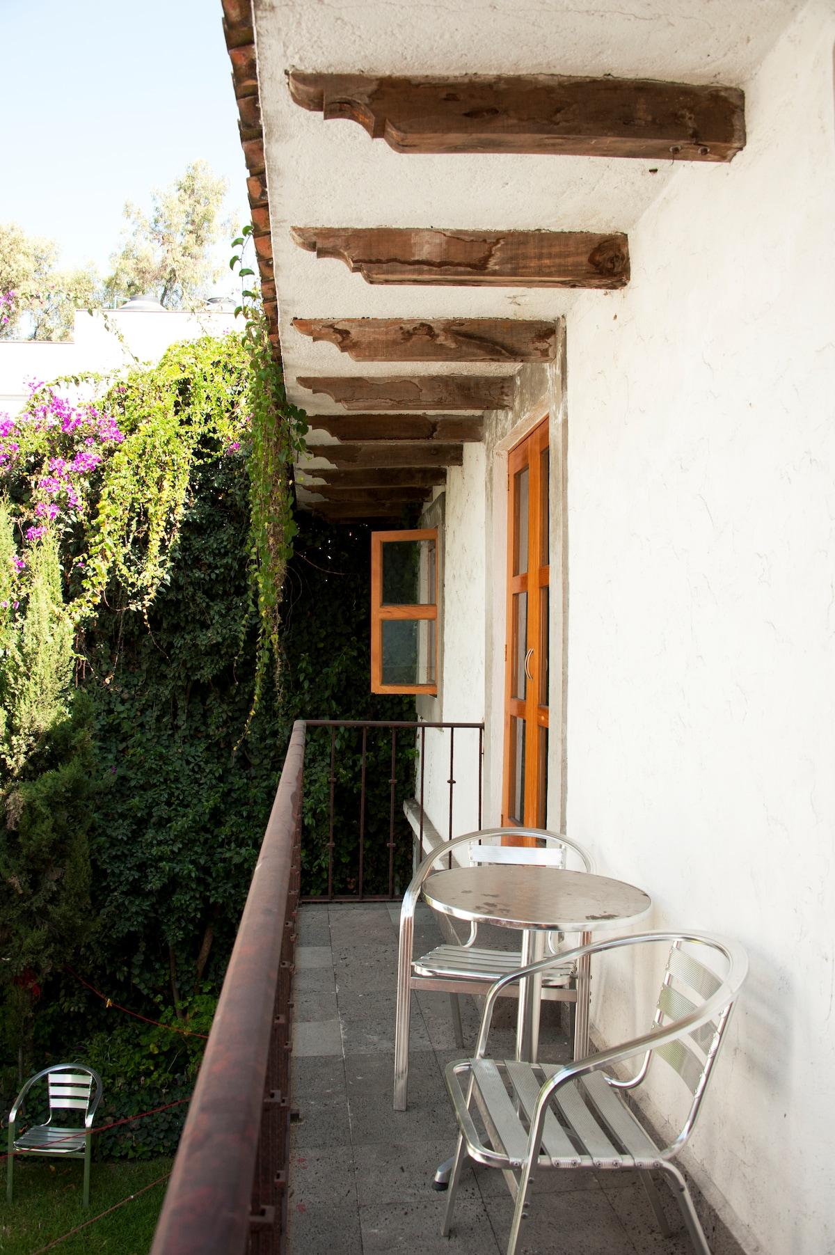 """La terraza' that overlooks the communal garden, leading to 'habitaciones: bugambilia & dalia'"