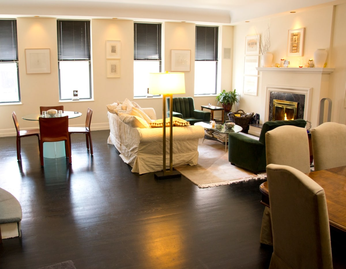 This is the living room area. Guests are welcome to relax in it and to use the fireplace.