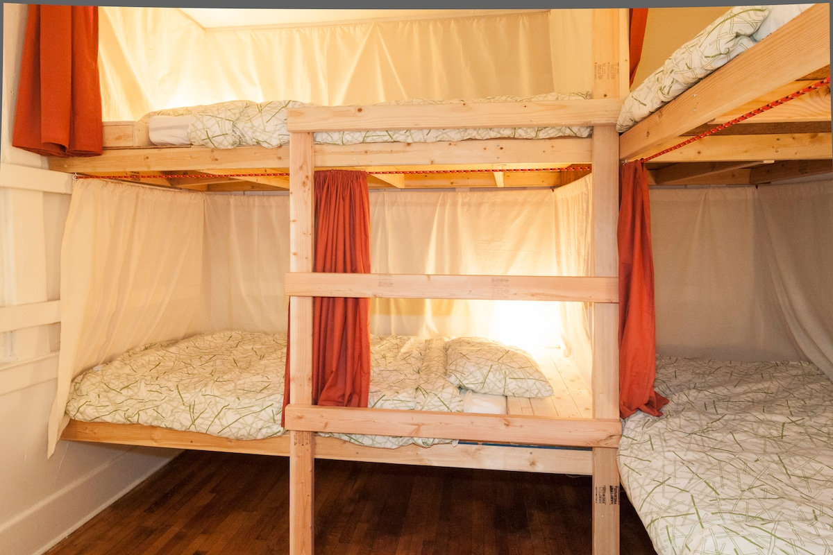 Hand-sewn curtains surrounding each bunk for privacy