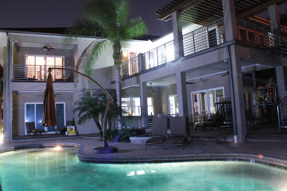 POOL AND BACK YARD AT NIGHT