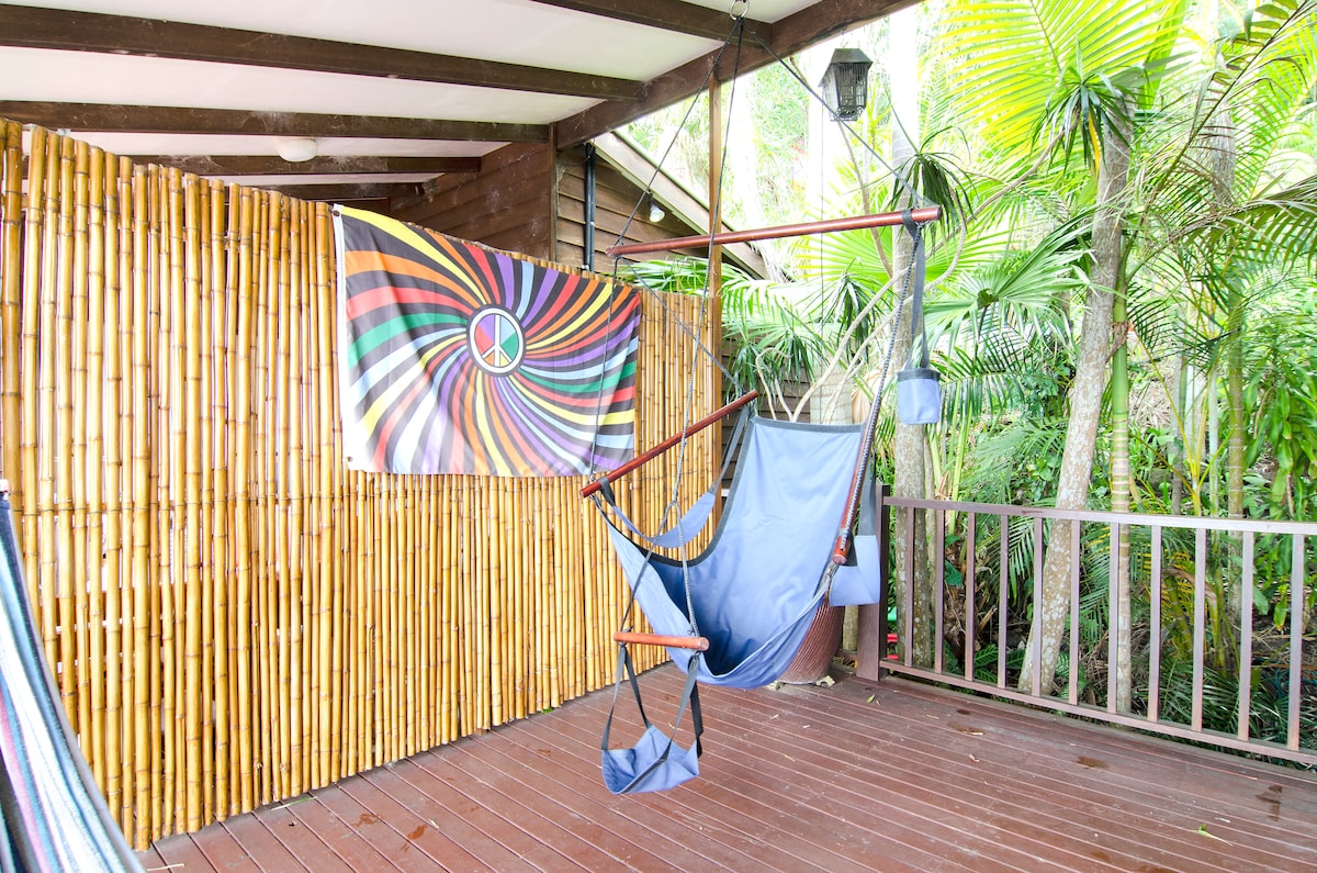 Paraglider hammock and screen that divides the rest of the house.