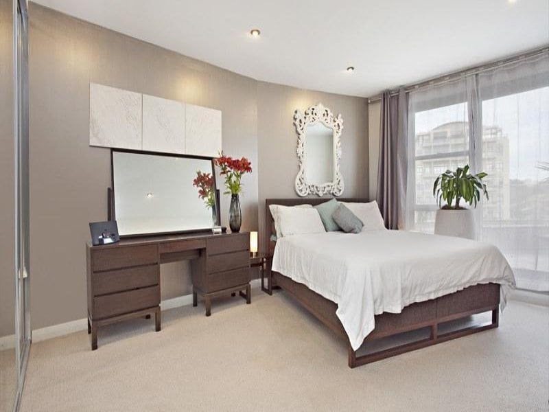 The master bedroom has a super comfy king sized bed with an ensuite bathroom and balcony.