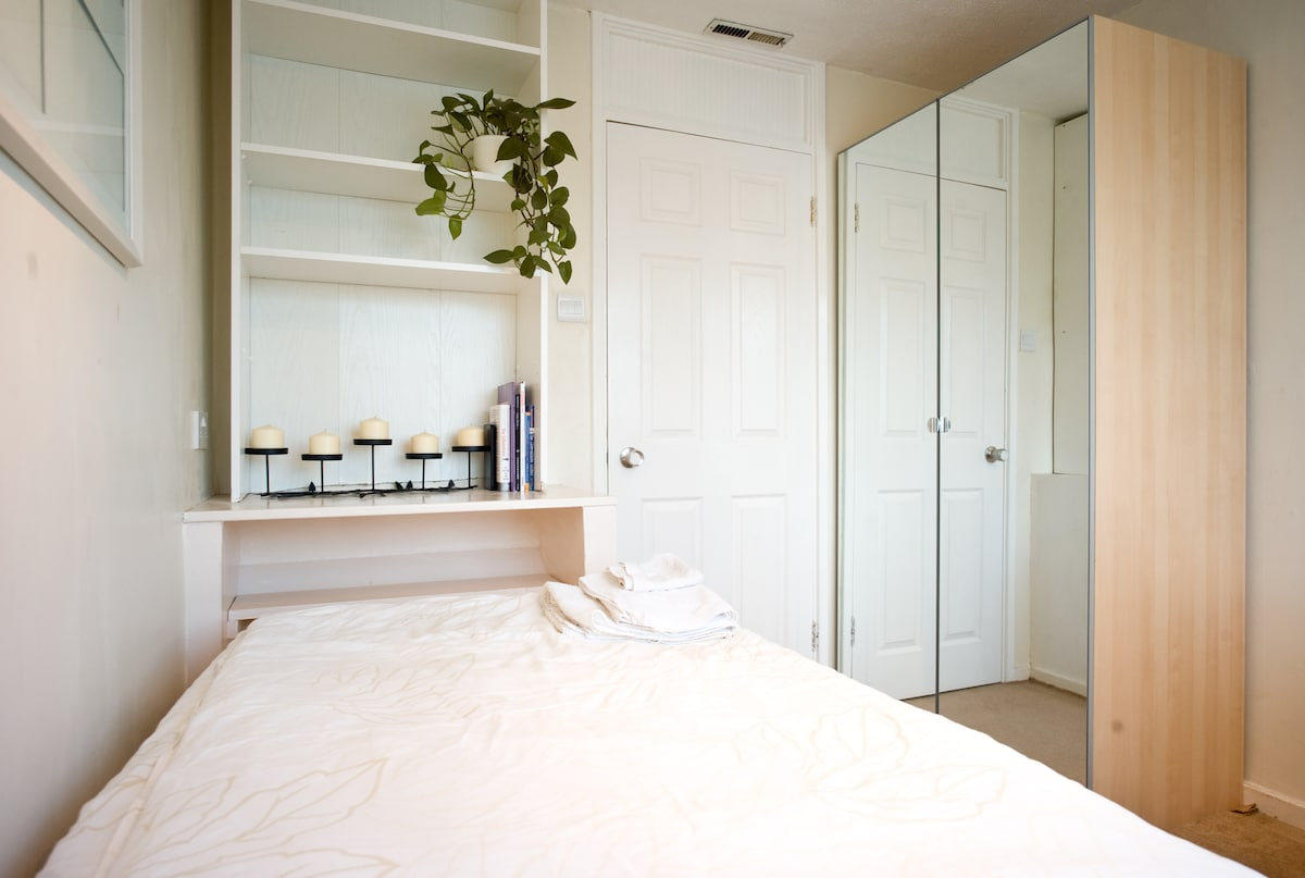 large shelf space - behind the room door is the double wardrobe with full length mirrors