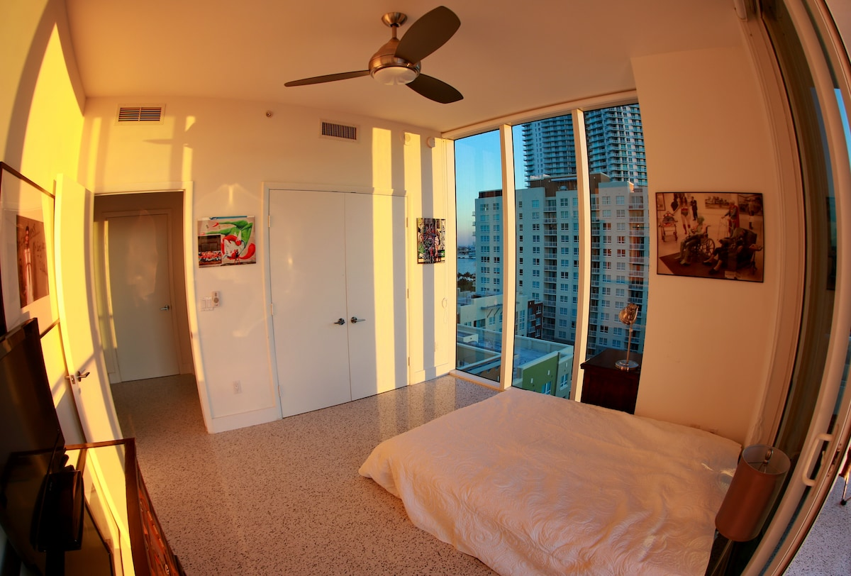 Bedroom offered. 10 foot ceilings/windows to the south and west. (detailed description under 1st photo); photo taken just before sunset