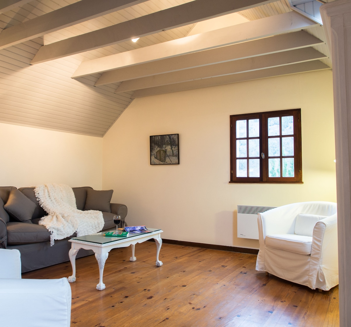 Comfortable, light-filled living room in this delightful, peaceful one bedroom cottage.