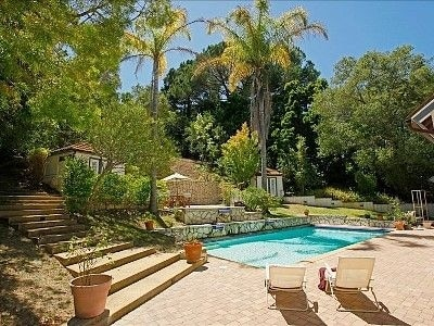 Backyard Oasis with stairs that lead up the hill!