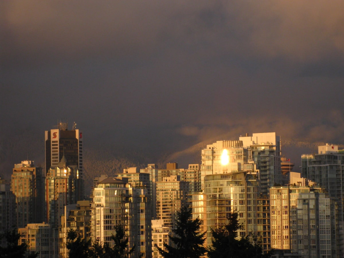 Sunset view of the city and snowy mountain backdrop - taken from my upper balcony steps.