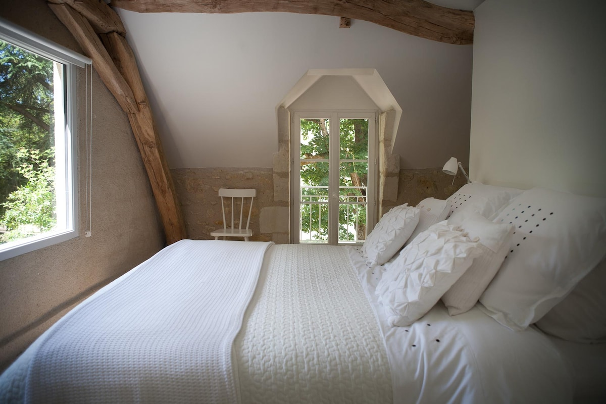 The ensuite bedroom with two large windows