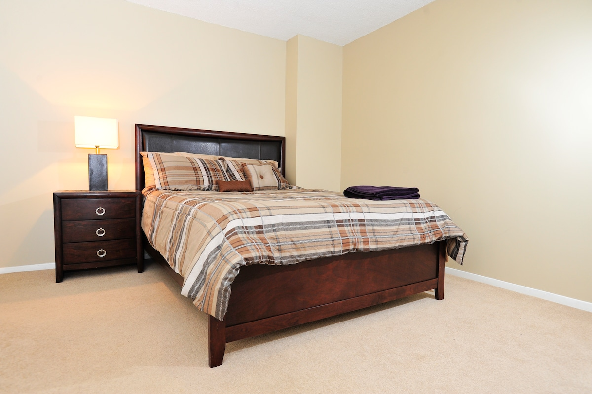 Your room which is a master bedroom with a walk in closet