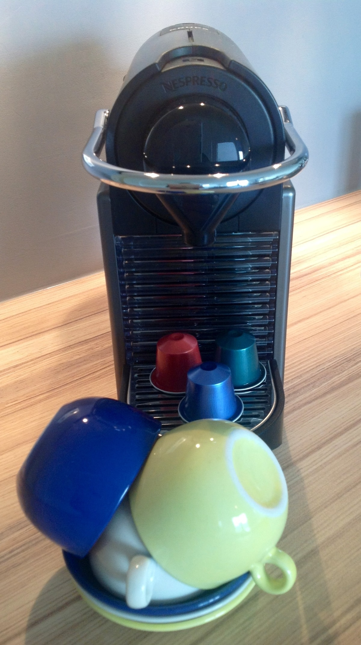Our nespresso machine is for your use and the first days cups are free :0) you can pick up a fresh supply at the Bijenkorf  !