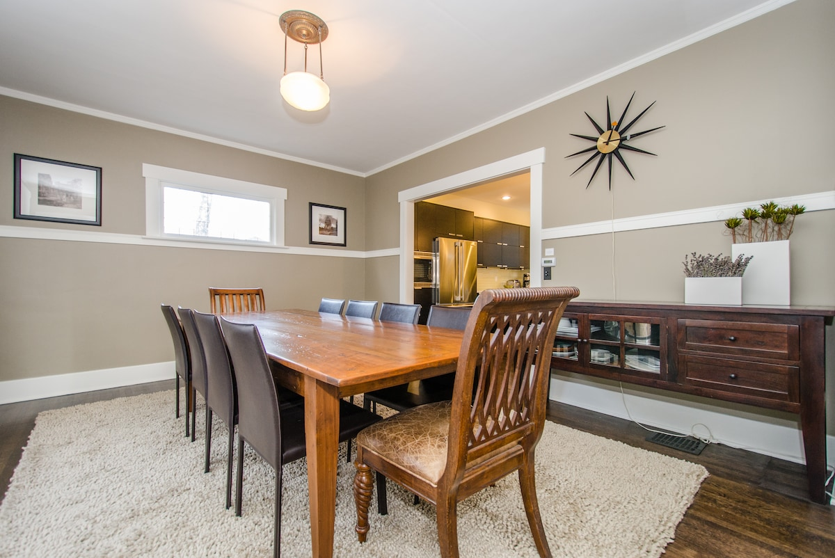 Huge dining room with handmade 9-foot farmhouse table seats 10.
