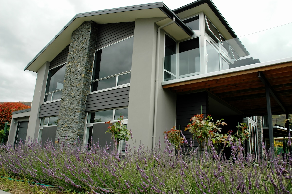 Front entrance, with off-street parking,framed by lavender and scented white roses